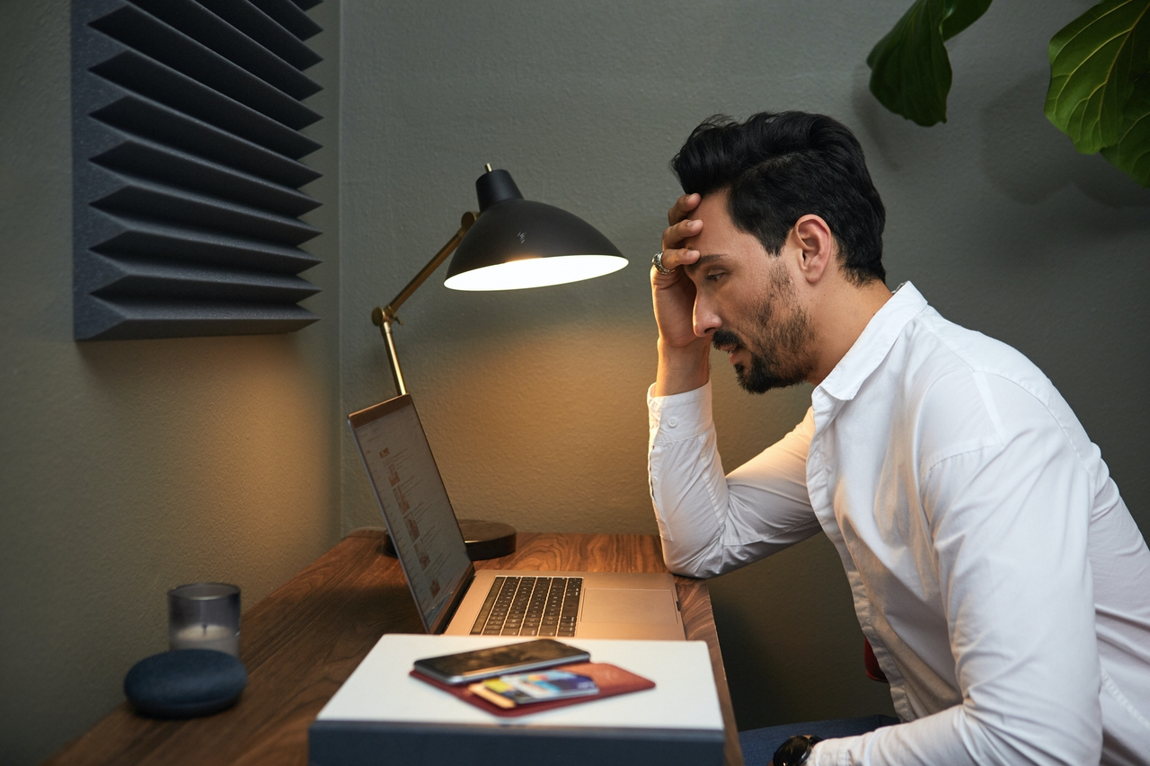 stressed man looking at a computer