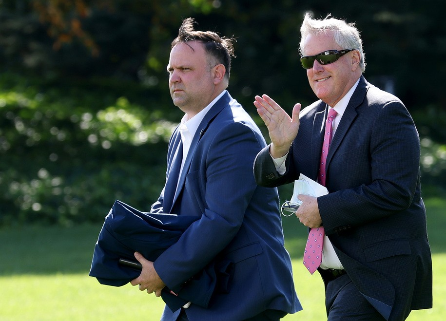 WASHINGTON, DC - OCTOBER 23: White House Chief of Staff Mark Meadows (R) and Assistant to the President Dan Scavino (L) depart the White House with U.S. President Donald Trump October 23, 2020 in Washington, DC. Trump is scheduled to travel to Florida today. (Photo by Win McNamee/Getty Images)
