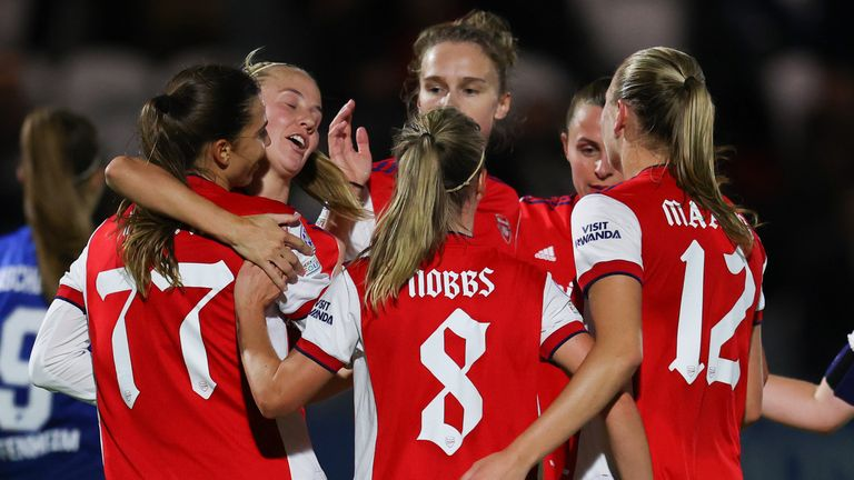 Tobin Heath is congratulated by her team-mates after giving Arsenal a two-goal lead
